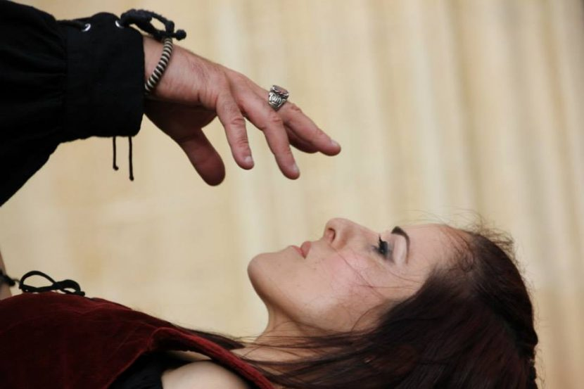 Lola Palmer being hypnotised by Magician Brian Role during the Medieval Mdina Festival in Malta